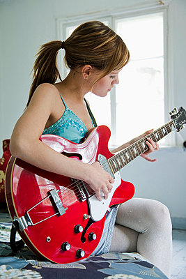 Girl with red guitar - p4265623f by Tuomas Marttila