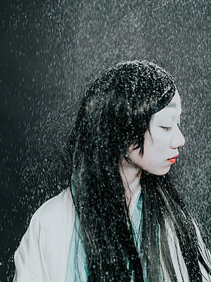 Young Asian woman in the artificial snow - p1184m1441224 by brabanski