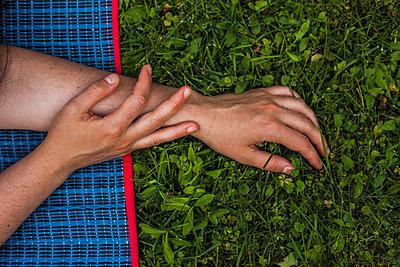 Female hands on grass - p1296m1527699 by Jean-François Brière