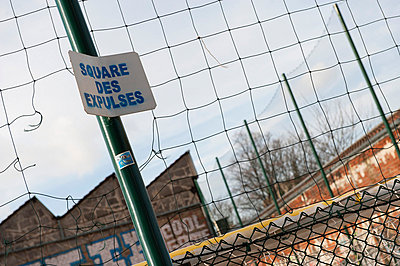 """Wire fence with sign saying """"square des expluses"""" - p62322218f by Jerome Gorin"""
