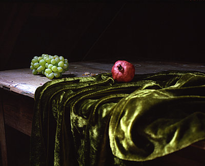 Grapes and pomegranate on velvet - p945m1480849 by aurelia frey