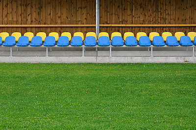 Germany, Bavaria, Munich, Stand with blue and yellow plastic seats - p300m752613f by Axel Ganguin