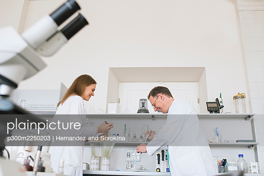 Researchers in white coats working in lab - p300m2250203 by Hernandez and Sorokina