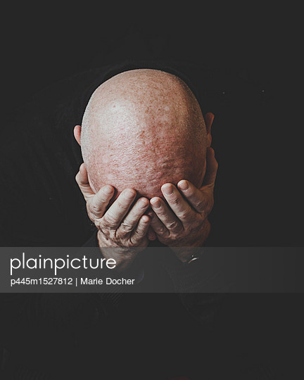 Bald Head praying - p445m1527812 by Marie Docher