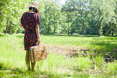 Woman Standing By Dried Marsh - p463m1066044 by Yo Oura