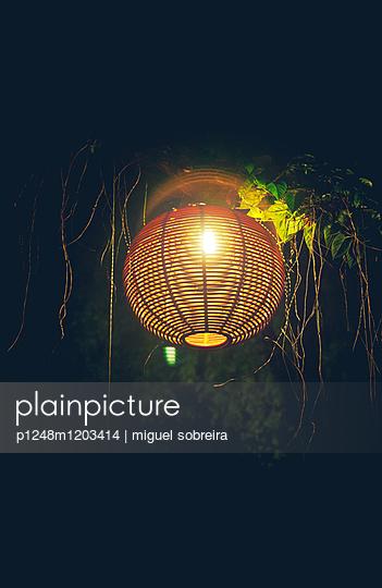 Lantern at night - p1248m1203414 by miguel sobreira