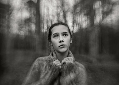 Girl in Forest Holding Sweater - p1503m2015973 by Deb Schwedhelm