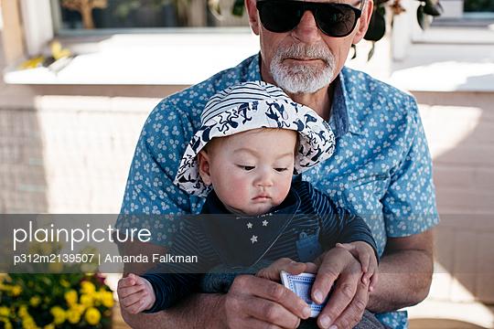 Grandfather with baby - p312m2139507 by Amanda Falkman