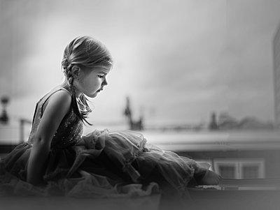 Girl in Long Dress Sitting on Window Frame - p1459m1526399 by Zoe Space