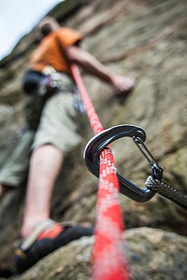 Climber mountain climbing with the help of rope and carabiner, Bohuslan, Sweden - p348m915845 by Jonas Tufvesson