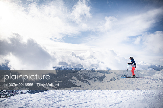 France, Skier on top of the mountain - p1007m2216555 by Tilby Vattard