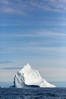 Majestic iceberg formation on sunny blue Atlantic Ocean Greenland - p1023m2161549 by Martin Barraud