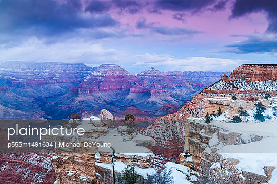 Scenic view of snow at canyon - p555m1491634 by Michael DeYoung