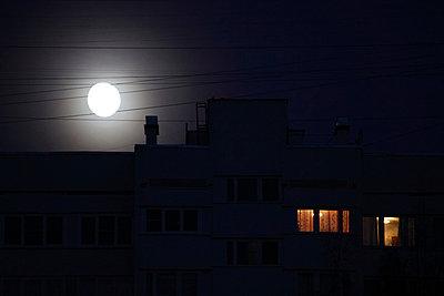 Moon and city - p1063m912477 by Ekaterina Vasilyeva
