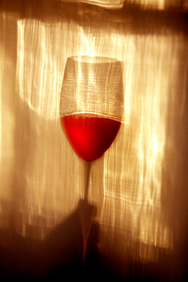 Shadow of red wine glass - p1072m829010 by George Robinson