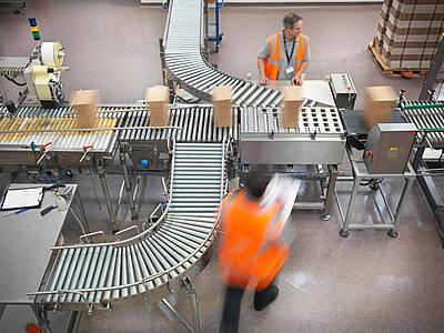 Factory workers in bottling plant - p42914120f by Monty Rakusen