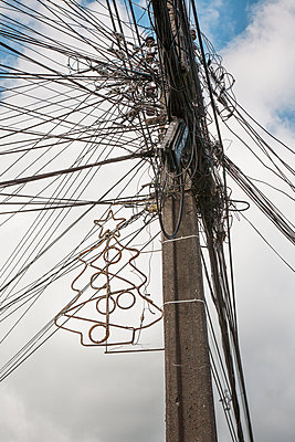 Telephone lines and christmas decoration - p1038m2087608 by BlueHouseProject