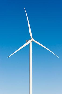 Wind turbine against blue sky - p1079m1042379 by Ulrich Mertens