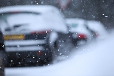 Snow flakes and row of cars - p924m806965f by Simon Battensby