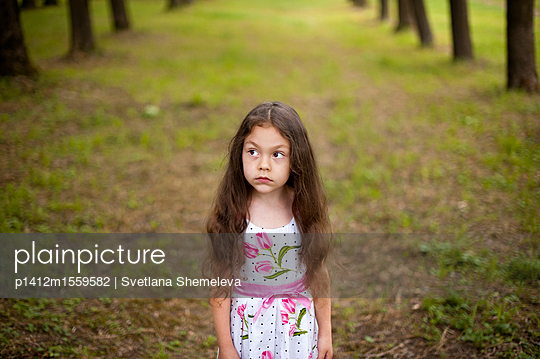 Portrait of a little girl in the park - p1412m1559582 by Svetlana Shemeleva
