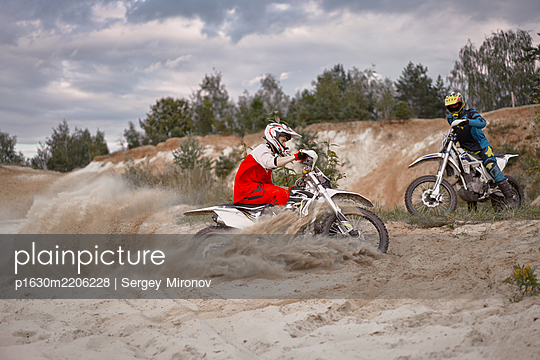 Two motorbikers on motocross racing course - p1630m2206228 by Sergey Mironov