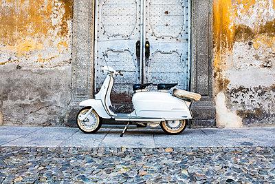 White Lambretta Innocenti scooter in the old town, Morbegno, province of Sondrio, Valtellina, Lombardy, Italy, - p651m2033184 by Roberto Moiola
