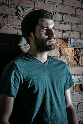 Bearded Young Man in Green  - p1019m1122383 by Stephen Carroll