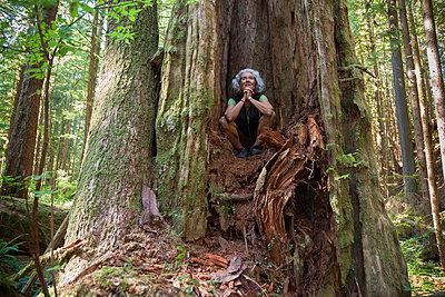 A senior woman in avatar forest on vancouver island near port renfrew; british columbia canada - p442m767647f by Debra Brash
