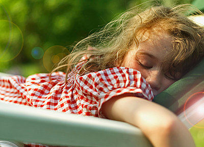 Girl sleeping outdoors - p429m803554f by Owen Smith