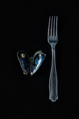 Fork beside mussel - p947m1492710 by Cristopher Civitillo