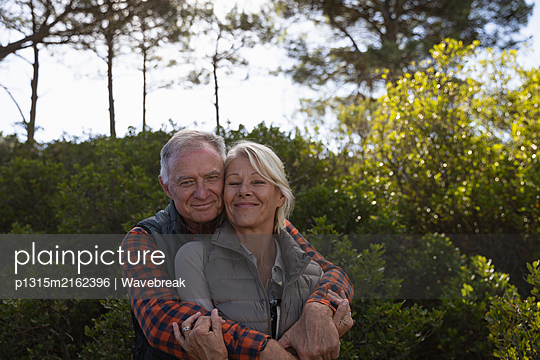 Couple enjoying time outside in nature - p1315m2162396 by Wavebreak