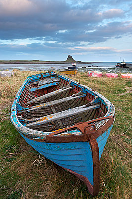 Old fishing boat pulled up on the shore at Holy Island - p871m838827 by Adam Burton