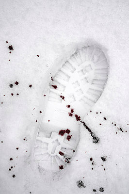 Blood and shoe prints in snow - p971m865865 by Reilika Landen