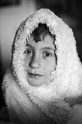 Boy Wrapped in White Blanket - p1169m2108470 by Tytia Habing