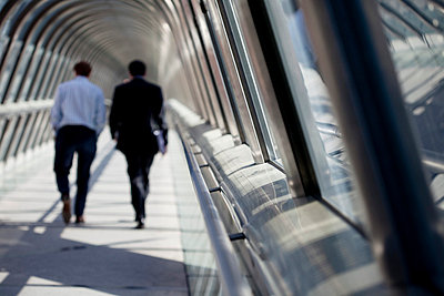 Businessmen in a passage - p4450502 by Marie Docher