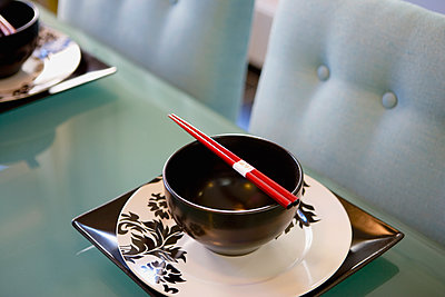 Contemporary Dining Table with Place Settings and Chopsticks - p555m1304299 by BUILT Images