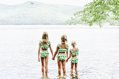 Three girls by the lake - p1086m2149975 by Carrie Marie Burr