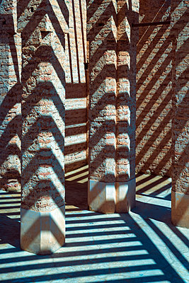 Concrete pillars with shadows - p1390m1591054 by Svetlana Sewell