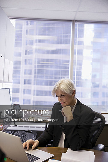 Female lawyer working at laptop in office
