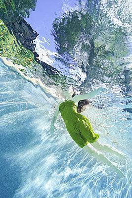 underwater ballet dancer woman  - p1554m2159061 by Tina Gutierrez