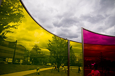 Curved panels reflects silhouettes of visitors at the 21st Century Museum of Contemporary Art, Kanazwa, Japan, Asia - p934m1177225 by Dominic Blewett
