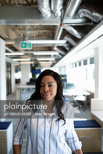 Portrait of mid adult businesswoman looking at camera - p1192m2123292 by Hero Images
