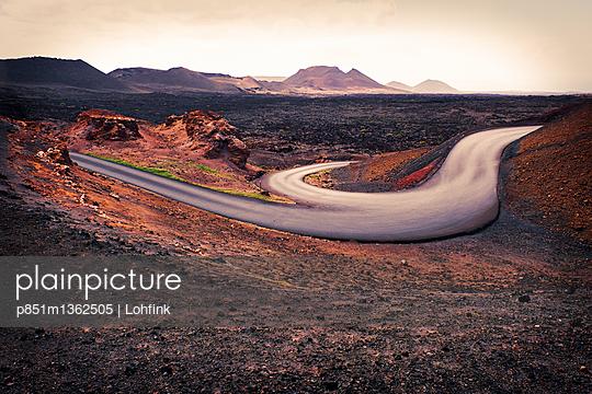 Winding road in volcanic landscape in Lanzarote - p851m1362505 by Lohfink