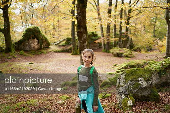 girl walking through a beech forest - p1166m2192029 by Cavan Images