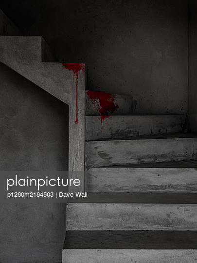 Blood stain on concrete staircase - p1280m2184503 by Dave Wall