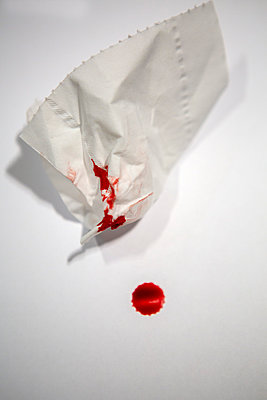 Tissue handkerchief with blood - p817m2159106 by Daniel K Schweitzer
