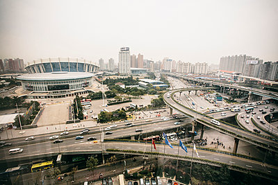 Motorway intersection in Shanghai, Shanghai stadium - p1085m1104899 by David Carreno Hansen