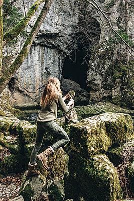 Woman explores the Rakov Skocjan cave system in Slovenia - p1455m2077128 by Ingmar Wein