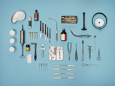 Directly above shot of medical tools on blue background - p301m1406235 by Nico Woehrle