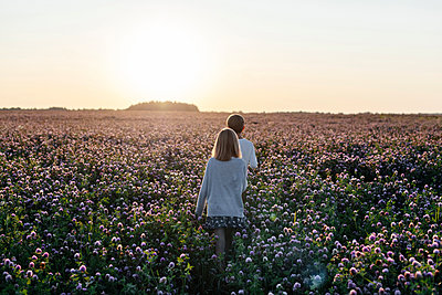 Two kids on a clover field - p300m2143861 by Ekaterina Yakunina